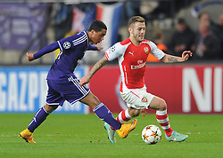 Arsenal's Jack Wilshere comes away from Anderlecht's Youri Tielemans - Photo mandatory by-line: Dougie Allward/JMP - Mobile: 07966 386802 - 22/10/2014 - SPORT - Football - Anderlecht - Constant Vanden Stockstadion - R.S.C. Anderlecht v Arsenal - UEFA Champions League - Group D