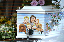 Pictured is the coffin with a portrait of Peaches Geldof and her family.<br /> Friends and family arrive at St Mary Magdalene and St Lawrence church in the village of Davington, Kent, to the funeral of Peaches Geldof.<br /> Monday, 21st April 2014. Picture by Ben Stevens / i-Images.<br /> File photo - Peaches Geldof  died of heroin overdose coroner rules today Wednesday 23rd July 2014.