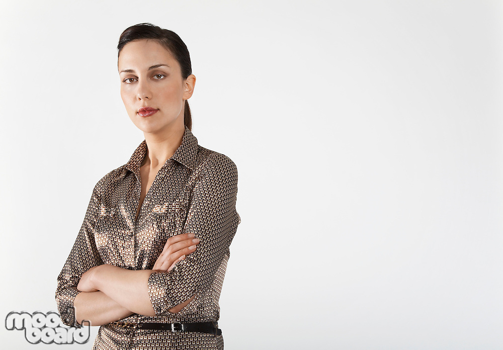 Businesswoman with arms crossed on white background portrait