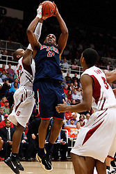 February 3, 2011; Stanford, CA, USA;  Arizona Wildcats forward Derrick Williams (23) shoots past Stanford Cardinal guard Jarrett Mann (22) during the second half at Maples Pavilion.  Arizona defeated Stanford 78-69.