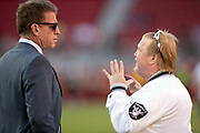 (L-R) FOX Sports television analyst and former quarterback Troy Aikman talks to Oakland Raiders team owner Mark Davis before the NFL week 9 regular season football game against the San Francisco 49ers on Thursday, Nov. 1, 2018 in Santa Clara, Calif. The 49ers won the game 34-3. (©Paul Anthony Spinelli)