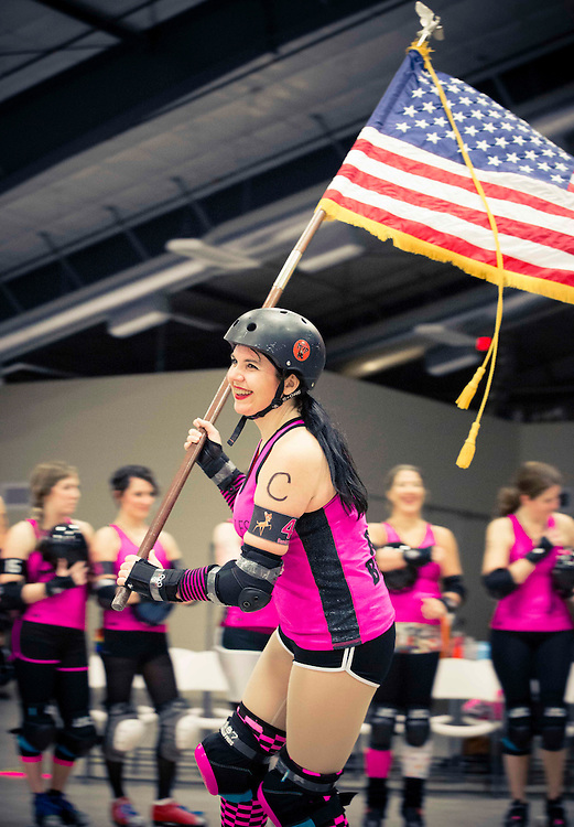 Hel'z Belles  Bambi Boozled (40) carries the flag during the opening ceremony of tonight's bout against the Flathead Valley Big Mountain Misfits.