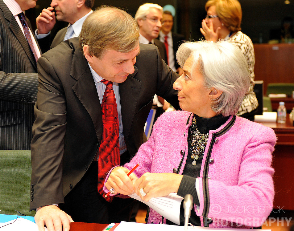 Jeannot Krecke, Luxembourg's minister of economy and foreign trade, left, speaks with Christine Lagarde, France's finance minister, during the meeting of European Union economic and finance ministers (ECOFIN) at the European Council headquarters, in Brussels, Belgium, Tuesday, Nov. 4, 2008. (Photo © Jock Fistick)