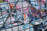 As the UK government considers further restrictions of movement in public places and the continued forced closure of restarants, cafes, gyms and cinemas etc. during the Coronavirus pandemic, old posters with a smiling face of remain crumpled behind security cages  in Loughborough Junction, on 23rd March 2020, in London, England.