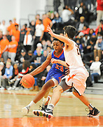 Newton South junior Njavan Stewart-Okiwe dribbles around Newton North senior Christian Negrotti during the game at Newton North, Dec. 27, 2018.   [Wicked Local Photo/James Jesson]