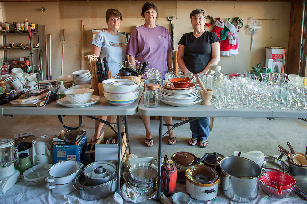 """Objects of a lifetime...""""Our father died on April 23rd at age 93...we've come back to Calistoga to clear out the house.""""  Cathy, Wendy and Toni, the daughters of Joe Massucco, prepare for tomorrow morning's garage sale."""