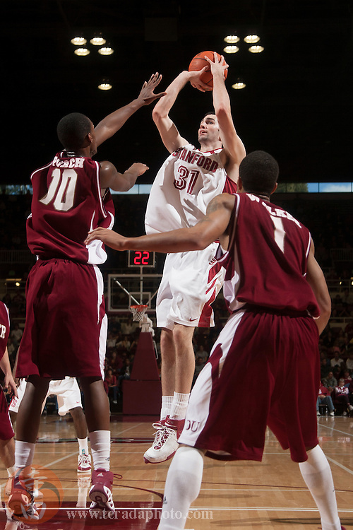November 25, 2006; Stanford, CA, USA; Stanford Cardinal forward Taj Finger (31) shoots the basketball against Denver Pioneers guard Antonio Porch (10) during the game at Maples Pavilion. The Cardinal defeated the Pioneers 82-39.