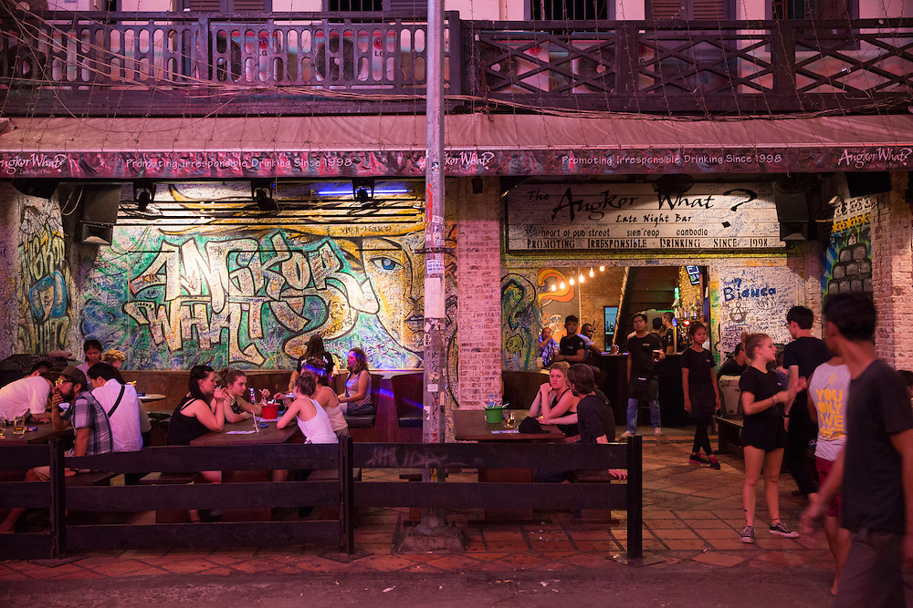 Tourists sit drinking and socialising outside the Angkor What? Bar on Pub Street in downtown Siem Reap, Cambodia, Asia. Siem Reap is the capital city of the Siem Reap Province.  Pub Street is a famous destination for lively nightlife for tourist and travellers as it restaurants and bars stay open late.  (photo by Andrew Aitchison / In pictures via Getty Images)