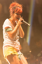 © Licensed to London News Pictures. 18/07/2014. Southwold, UK.   Lily Allen performing live at Latitude Festival 2014 on Day 1 wearing a Two Door Cinema Club t-shirt.  Lily Allen replaced Two Door Cinema Club as tonight's headline act  and has been receiving negative comments on twitter by disappointed Two Door Cinema Club fans.  Lily Allen replacing Two Door Cinema Club  was announced earlier this week as a result of Two Door Cinema Club's frontman Alex Trimble's ill health.   It was reported Trimble collapsed at an american airport.   The Latitude Festival is a British annual music festival.  Photo credit : Richard Isaac/LNP