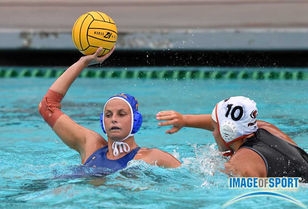 UCLA Bruins attacker Bronte Halligan (25) is defended by Pacific Tigers attacker Viktoria Szmodics (10) during an NCAA college women's water polo quarterfinal game in Los Angeles, Friday, May 11, 2018. UCLA defeated Pacific, 8-4.