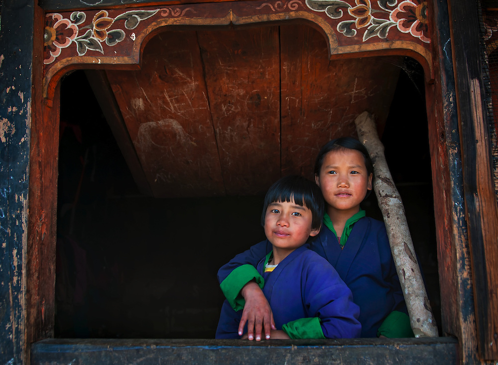 Girls wearing traditional clothes in the mountains of eastern Bhutan.