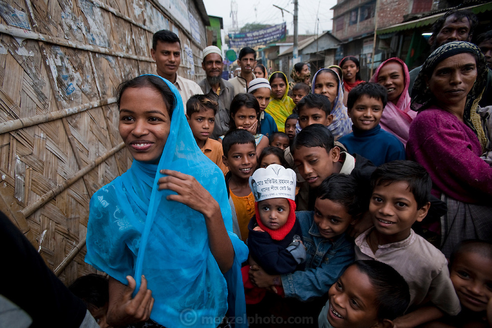 Ruma Akhter (far left) with her neighbors outside her family home in Dhaka, Bangladesh. (Featured in the book What I Eat: Around the World in 80 Diets.) MODEL RELEASED.