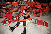 A luchador gets thrown out of the ing and into a row of folding chairs at a neighborhood arena in Ciudad Juarez, Mexico.