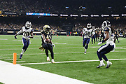 Nov 4, 2018; New Orleans, LA, USA: New Orleans Saints running back Alvin Kamara (41) scores a touchdown in the first quarter of play at the Mercedes-Benz Superdome against the Los Angeles Rams. The Saints beat the Rams 45-35. (Steve Jacobson/Image of Sport)