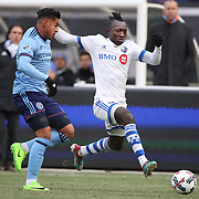 NEW YORK, NEW YORK - March 18: Dominic Oduro #7 of Montreal Impact challenged by Ronald Matarrita #22 of New York City FC  during the New York City FC Vs Montreal Impact regular season MLS game at Yankee Stadium on March 18, 2017 in New York City. (Photo by Tim Clayton/Corbis via Getty Images)