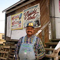 Willie Seaberry works on a cotton farm near Merigold by day, and operates Po Monkeys juke joint on Thursday nights.