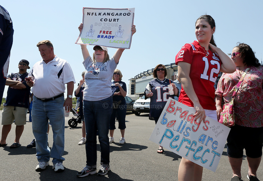 "(Foxboro, MA - 5/24/15) [READ SIGN ON RIGHT BEORE POSTING] Bianca Bullock of Tampa [originally from Mansfield], right, joins Patriots fans in the ""Free Tom Brady"" rally at Gillette Stadium, Sunday, May 24, 2015. Staff photo by Angela Rowlings."