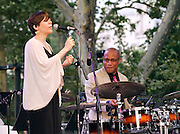 Gretchen Parlato and Otis Brown III perform during the 75th Anniversary of Blue Note Records concert in association with Revive Music celebrating 15 years of Okayplayer at SummerStage in Rumsey Playfield in New York City, NY on August 3, 2014.