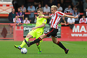 Will Beesley and Danny Wright during the Vanarama National League match between Cheltenham Town and Southport at Whaddon Road, Cheltenham, England on 15 August 2015. Photo by Antony Thompson.