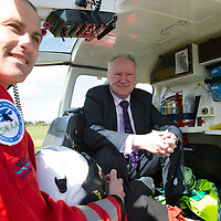 Scotland's Charity Air Ambulance (SCAA) Lead Paramedic John Pritchard picture with Minister for Health Alex Neil at Perth Airport.....22.05.13 <br /> G-CDBS is a Bolkow 105 helicopter operated by Bond Aviation Services and will work alongside the two NHS funded air ambulances in Glasgow and Inverness. Her call sign will be 'Helimed 76' The crew went live at 1pm after a simulated light plane crash rescue at Perth Airport. <br /> Picture by Graeme Hart.<br /> Copyright Perthshire Picture Agency<br /> Tel: 01738 623350  Mobile: 07990 594431