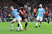 Oleksandr Zinchenko (35) of Manchester City battles for possession with Adam Smith (15) of AFC Bournemouth during the Premier League match between Bournemouth and Manchester City at the Vitality Stadium, Bournemouth, England on 2 March 2019.