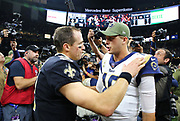 Nov 4, 2018; New Orleans, LA, USA: New Orleans Saints quarterback Drew Brees (9) and Los Angeles Rams quarterback Jared Goff (16) greet each other during postgame at the Mercedes-Benz Superdome. The Saints beat the Rams 45-35. (Steve Jacobson/Image of Sport)