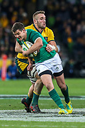 Johnny Sexton of Ireland is tackled by Izack Rodda of the Australian Wallabies during the Australian Wallabies vs Ireland second Mitsubishi Estate test match at AAMI Park, Melbourne, Australia on 16 June 2018. Picture by Martin Keep.