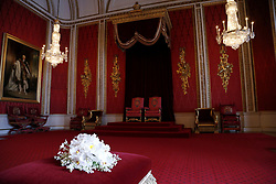 A replica of the Coronation Bouquet presented to Queen Elizabeth II by the Worshipful Company of Gardeners in the Throne Room against the backdrop of the original coronation thrones at Buckingham Palace, London.