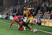 Jennison Myrie-Williams of Newport County skips past Kallum Mantack of Alfreton Town during the The FA Cup match between Newport County and Alfreton Town at Rodney Parade, Newport, Wales on 15 November 2016. Photo by Andrew Lewis.