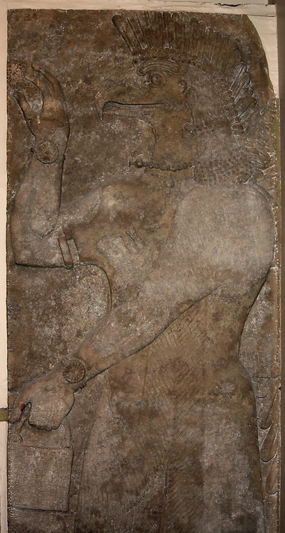 Wall carving of Eagle-headed protective spirit. Assyrian, (approx. 865-860 BC). From the North-West Palace in Nimrud.