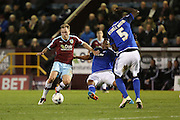 Kagisho Dikgacoi of Cardiff City  successfully makes a sliding tackle on Scott Arfield of Burnley during the Sky Bet Championship match between Burnley and Cardiff City at Turf Moor, Burnley, England on 5 April 2016. Photo by Simon Brady.