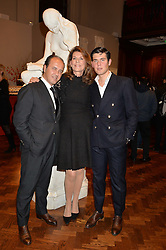 Left to right, PROSPER ASSOULINE,  MARTINE ASSOULINE and ALEX ASSOULINE at a party to celebrate the launch of the Maison Assouline Flagship Store at 196a Piccadilly, London on 28th October 2014.  During the evening Valentino signed copies of his new book - At The Emperor's Table.