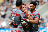 Benjamin Garcia (C) of Catalans Dragons celebrates scoring his try with team Brayden WILIAME (L) against Salford Red Devils during the Betfred Super League match at the Dacia Magic Weekend, St. James's Park, Newcastle<br /> Picture by Stephen Gaunt/Focus Images Ltd +447904 833202<br /> 20/05/2018
