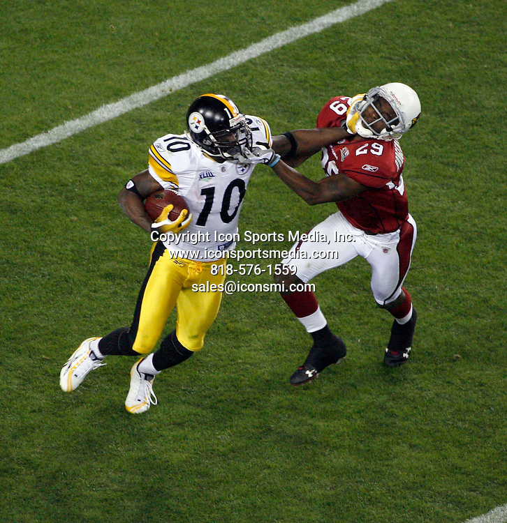 Feb 01, 2009 - Tampa, Florida, USA - A Steelers pass short right to (10)-Santonio Holmes pushed ob at PIT 21 for 6 yards by (29)-D.Rodgers-Cromartie...Super Bowl XLIII between the Arizona Cardinals and the Pittsburgh Steelers on February 1, 2009 at Raymond James Stadium