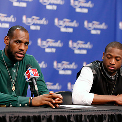 Jun 16, 2013; San Antonio, TX, USA; Miami Heat shooting guard Dwyane Wade (right) and small forward LeBron James addresses the media after game five in the 2013 NBA Finals against the San Antonio Spurs at the AT&T Center. San Antonio Spurs won 114-104. Mandatory Credit: Derick E. Hingle-USA TODAY Sports