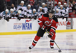 Oct 21; Newark, NJ, USA; New Jersey Devils left wing Zach Parise (9) skates in on a penalty shot during the second period at the Prudential Center.