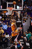 Apr 1, 2016; Phoenix, AZ, USA; Phoenix Suns forward P.J. Tucker (17) drives the ball against Washington Wizards guard Bradley Beal (3) in the first half at Talking Stick Resort Arena. Mandatory Credit: Jennifer Stewart-USA TODAY Sports
