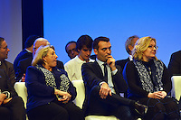 LYON, FRANCE - NOVEMBER 30: Party Vice President Florian Philippot listens as Marine Le Pen speaks from the podium at the far-right National Party's 15th congress on November 30, 2014 in Lyon, France. Le Pen won 100 percent backing to remain chief of the party, founded by her father and predecessor Jean-Maire Le Pen. Marine Le Pen is expected to make a bid for the country's presidency in 2017. (Photo by Bruno Vigneron/Getty Images)