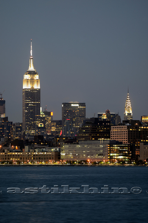 Empire State Building, Chrysler Building, New York City with Manhattan Skyline at night.