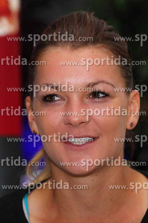 22.04.2014, Porsche Arena, Stuttgart, GER, WTA Tour, Stuttgart Porsche Grand Prix, im Bild Agnieszka Radwanska im Gespraech // during the Stuttgart Porsche Grand Prix WTA Tour at the Porsche Arena in Stuttgart, Germany on 2014/04/22. EXPA Pictures &copy; 2014, PhotoCredit: EXPA/ Eibner-Pressefoto/ Neis<br /> <br /> *****ATTENTION - OUT of GER*****