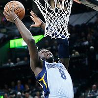 04 April 2017: Memphis Grizzlies forward James Ennis III (8) goes for the layup against San Antonio Spurs forward Kawhi Leonard (2) during the San Antonio Spurs 95-89 OT victory over the Memphis Grizzlies, at the AT&T Center, San Antonio, Texas, USA.