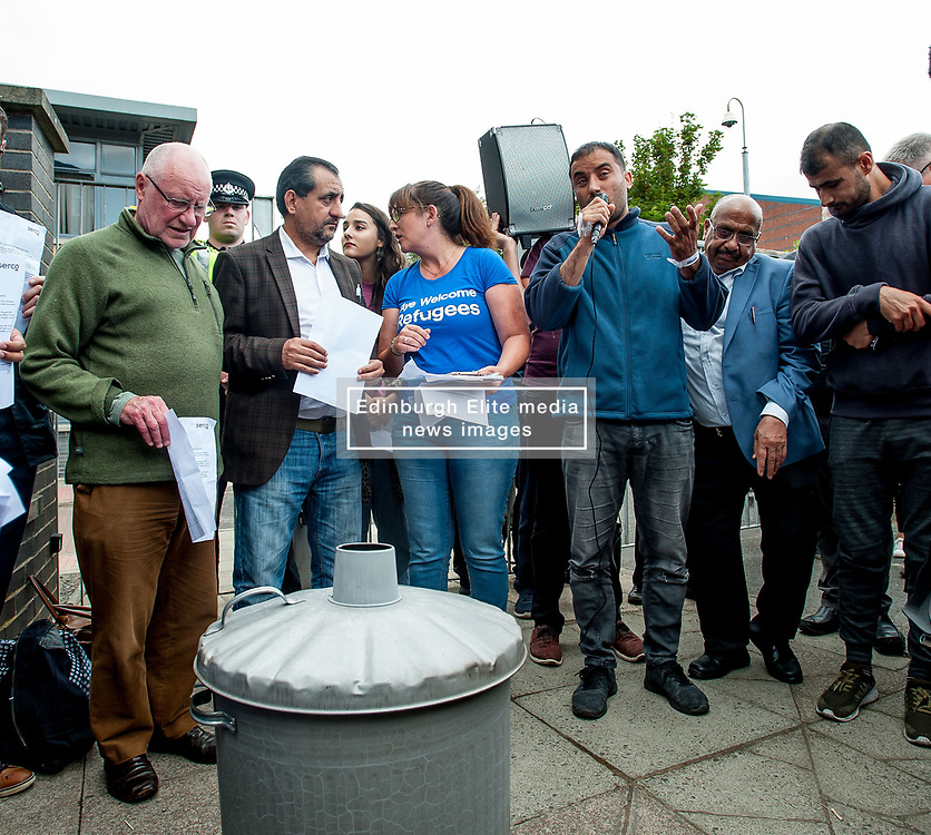 Pictured: Refugee and Rahman Shah talks to the protesters.<br /> <br /> Protesters gathered outside the main Home Office building in Glasgow to protest at private company SERCO's attempts to evict failed asylum seekers from their homes.<br /> <br /> © Dave Johnston / EEm