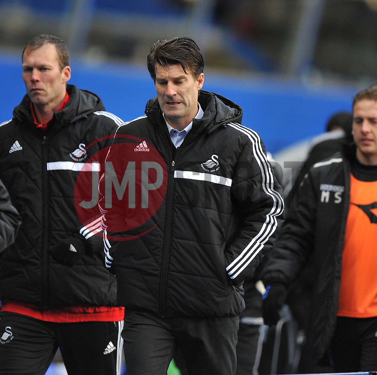 Swansea City Manager, Michael Laudrup walks off after the first half with his head down. - Photo mandatory by-line: Alex James/JMP - Tel: Mobile: 07966 386802 25/01/2014 - SPORT - FOOTBALL - St Andrew's - Birmingham - Birmingham City v Swansea City - FA Cup - Forth Round