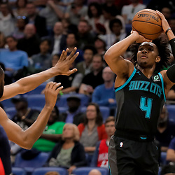 Apr 3, 2019; New Orleans, LA, USA;  Charlotte Hornets guard Devonte' Graham (4) shoots over New Orleans Pelicans guard Ian Clark (2) during the second quarter at the Smoothie King Center. Mandatory Credit: Derick E. Hingle-USA TODAY Sports