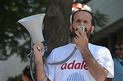 July 8, 2017 - Ankara, Turkey - A man speaks during a protest against decree-law dismissals in the state of emergency in Ankara, Turkey on July 08, 2017. More than 100,000 people including academics, doctors, police officers, soldiers and teachers, branded as terrorists and banned from public service since start of the investigation into the failed coup attempt on July 15, 2016. (Credit Image: © Altan Gocher/NurPhoto via ZUMA Press)