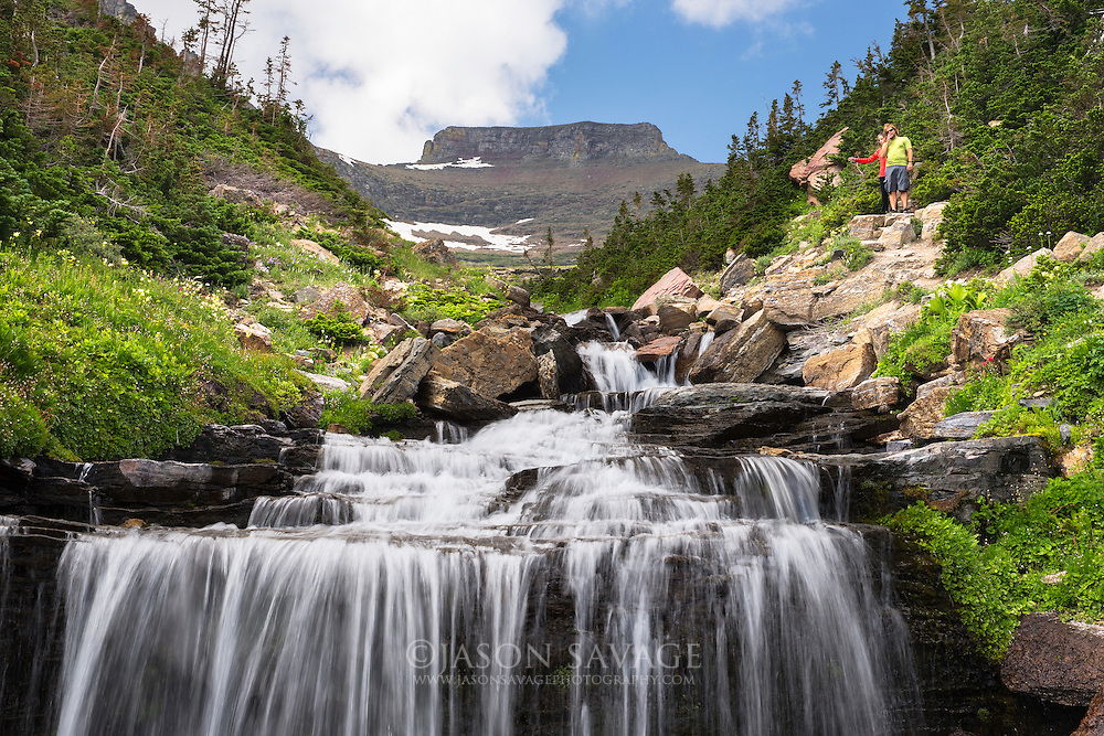 A couple hike up Lunch Creek in Glacier National Park, Montana.