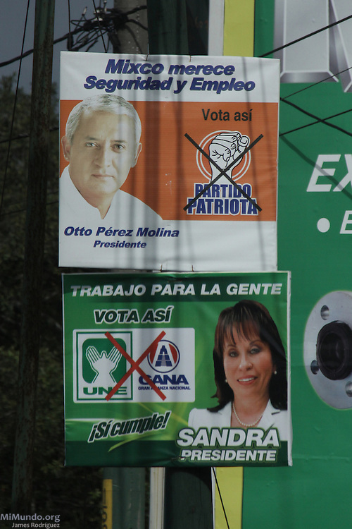 Political advertisements for 2011 presidential candidates Otto Perez Molina of the Patriota Party and Sandra Torres of the UNE party. Sandra Torres, former wife of President Alvaro Colom, was ultimately denied her candidacy due to a law that prevents family members of incumbent presidents to run for office. It was widely speculated Torres would have won the election and posed a real threat to former General Perez Molina. Mixco, Guatemala, Guatemala. July 8, 2011.