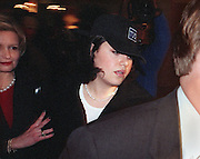 "Monica Lewinsky(C) is escorted by an unidentified aid(L) and security as she arrives at her hotel in Washington, DC 23 January. Lewinsky was called to return to Washington by a US federal court judge after he ordered her to talk to US House of Representatives ""managers"" prosecuting US President Bill Clinton in his impeachment trial.   AFP PHOTO     Bob PEARSON"