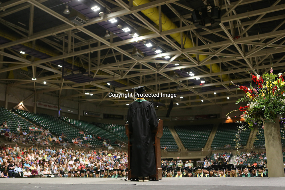 Mooreville High School valedictorian Bo Thomas delivers his valedictory speech to the crowd gathered for Mooreville's graduation ceremony Saturday afternoon at the BancorpSouth Arena.
