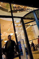 4 October, 2008.  A customer exits a Banana Republic store on 34th street and Fifth ave. As the financial crisis spread last month, many retailers hit the panic button, offering more generous discounts than they did at the same time last year. But the promotions did little to convince cautious shoppers to open their wallets.<br /> <br /> ©2008 Gianni Cipriano for The Wall Street Journal<br /> cell. +1 646 465 2168 (USA)<br /> cell. +1 328 567 7923 (Italy)<br /> gianni@giannicipriano.com<br /> www.giannicipriano.com